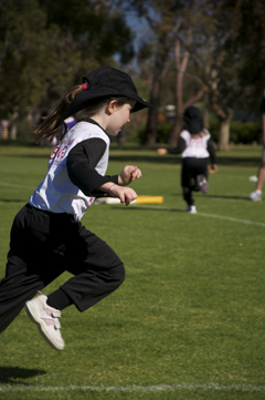 U7 tee-ball player running